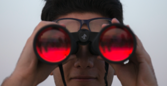 Person looking into binoculars