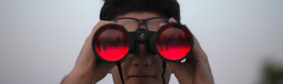 Person looking into binoculars