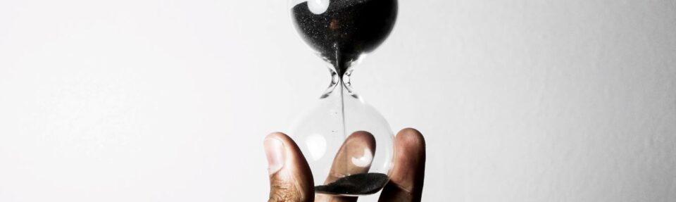 hand holding hourglass (1)