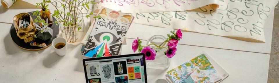 magazine creative materials and laptop